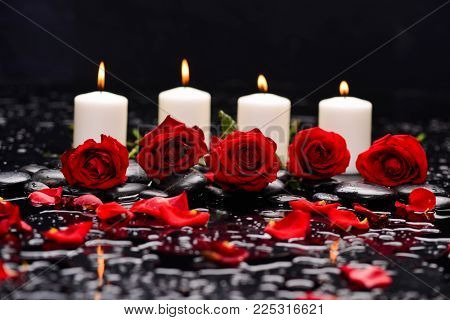 red rose, petals, with white candle and therapy stones