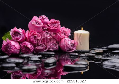 Lying down bouquet, rose ,petals with candle and therapy stones