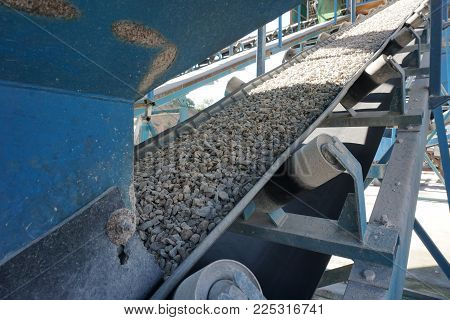 Aggregate transportation by conveyor belt at concrete mixing plant
