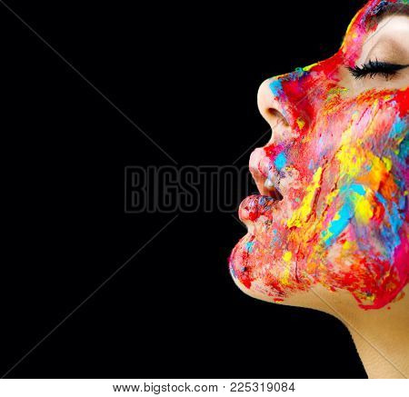 Fashion Model Girl colorful face paint. Beauty fashion art portrait, beautiful woman with painting smears, abstract makeup. Vivid paint make-up, bright colors. Multicolor creative make-up. Arts