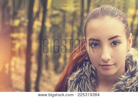 Cute Beautiful Pretty Redhead Female Teenager In Autumn Forest. Close Up Charming Portrait, Shallow