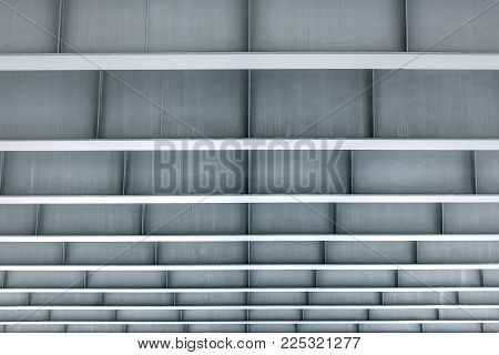 Modern architecture of minimalism building. View from under a metal construction of gray color with an even frame
