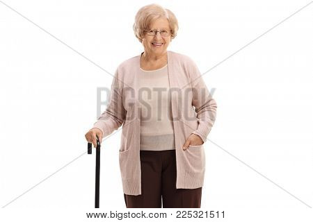 Elderly woman with a walking cane looking at the camera and smiling isolated on white background