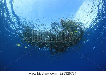 Abandoned fishing net. Ghost net environmental ocean pollution