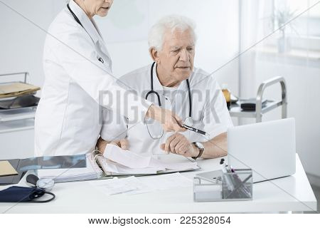 Doctors Discussing Medical Issue