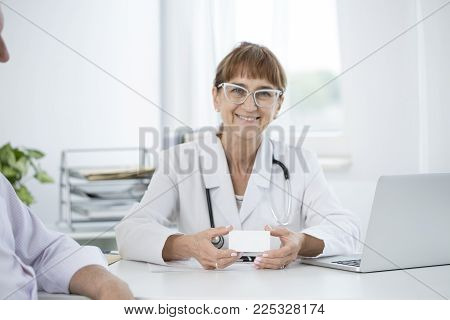Lady Holding Business Card