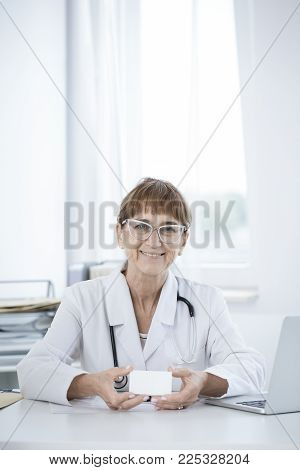 Doctor Holding Paper