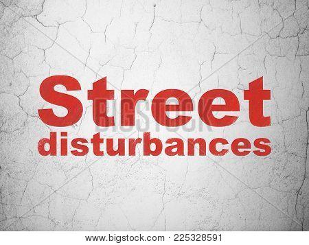 Politics concept: Red Street Disturbances on textured concrete wall background