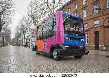 Toulouse, France - January 19 2018: Experimental driverless bus runs on pedestrian street Allee Jules Guesde