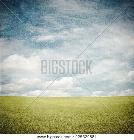 Grunge Image Of Green Field And Cloudy Sky