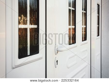 Front door PVC. White plastic front door with glass