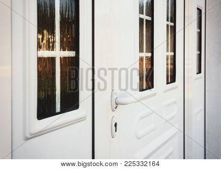 Front door PVC. White plastic front door with glass