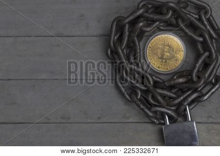 bitcoin placed in the center of chain with lock.