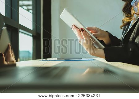 Businesswoman Using Tablet Computer At Workplace. Startup Woman Working With Computer At Office.  Yo