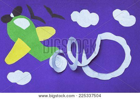 handmade airplane on violet paper. DIY concept. Child kinder artwork