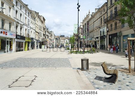 Niort, Deux-Sevres, France - July 2, 2012: Shops along Rue Victor Hugo in Niort on a summer day