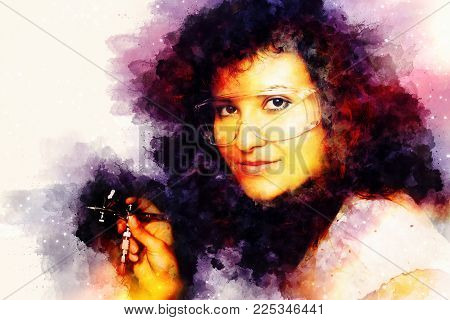 Woman holding airbrush gun and softly blurred watercolor background