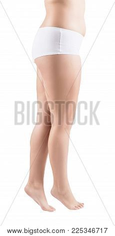 Fat legs of young woman isolated on white background. Obesity concept.
