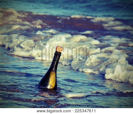 Secret Message In The Glass Bottle In The Ocean With Vintage Style Effect