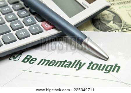 Be Mentally Tough Printed On Book With Calculator And Pen