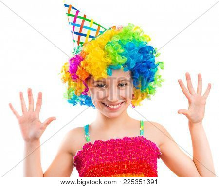Little funny girl in clown wig showing her palms out isolated on white background
