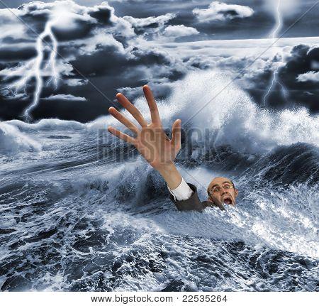 Businessman Sinking In Dark Stormy Sea