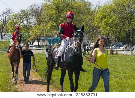 Pyatigorsk,Russia - May 02,2013:Horse racing is a popular sport in Russia and betting is possible.Before the horse race for the Otkritia prize, two horses and jockeys pass the sand track.Racecourse one of the oldest in Russia.