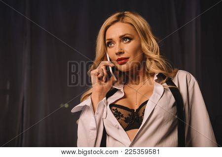 Sexy Woman In Unbuttoned Shirt And Black Bra Talking By Smartphone