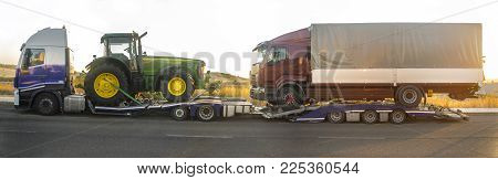 Badajoz, Spain - August 6th, 2017: Iveco Stralis E5 Heavy-duty truck with an auto-transport trailer carrying tractor and semi-trailer truck