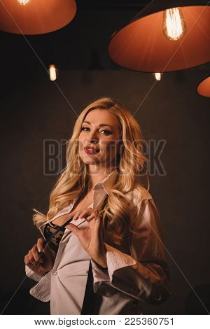 Sexy Beautiful Woman Standing In Unbuttoned Shirt And Holding Pencil