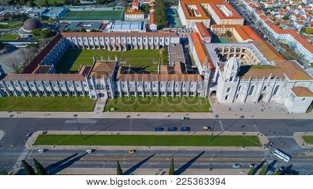 Surroundings of church and cloister of Mosteiro dos Jerónimos,Belém,Lisbon.The Jeronimos Monastery is National Pantheon,one of the important attractions of Portugal.Beautiful garden of Empire square