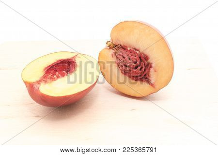 Nectarine in a cut with a bone isolated on a white background for any purpose
