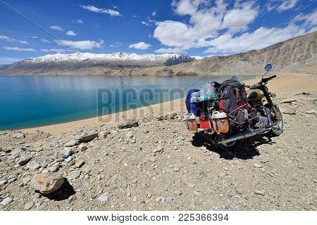Tso Moriri, Jammu And Kashmir, India - 05 July 2017: Motorbike Royal Enfield Standing By The Tso Mor