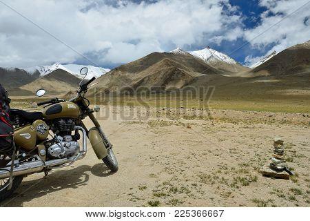Tso Kar, Jammu And Kashmir, India - 06 July 2017: Motorbike Royal Enfield Standing By The Tso Kar La