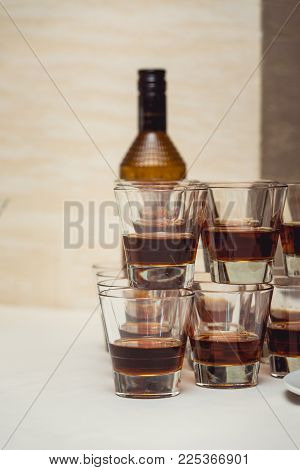 Pyramid of glasses of alcohol made in a pyramid for event party or wedding ceremony.