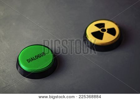 dialogue versus nuclear war concept. buttons on the table