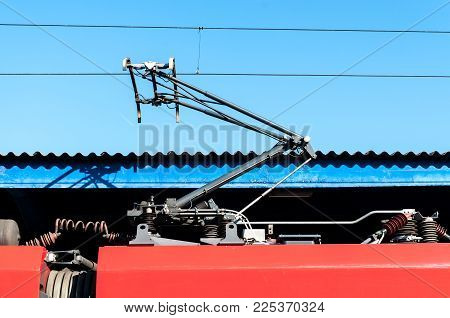 Electric train trolley pole railway electrification overhead system with wires and blue sky above