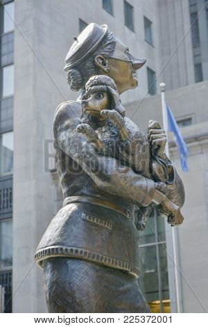 MONTREAL, CANADA - AUGUST 10, 2014: The statue The french poodle in Place d'Armes, Old City, Montreal, Quebec, Canada