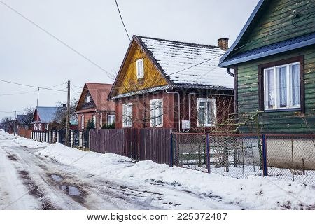 Row Of Traditional Wooden Folk Cottages In Soce, Small Village In Podlasie Region Of Poland