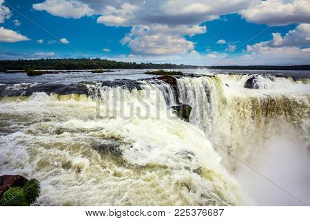 The most full-flowing waterfall in the world on the Parana River is the Garganta del Diablo. Concept of active, extreme, photographic and ecological tourism