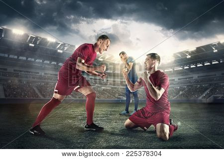 The football players in motion or attack, defense, fight on the field of stadium with lights. The professional football, soccer player and human emotions concept
