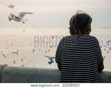 Back Of Old Women Standing Alone At The Sea And Looking For Some Thing.