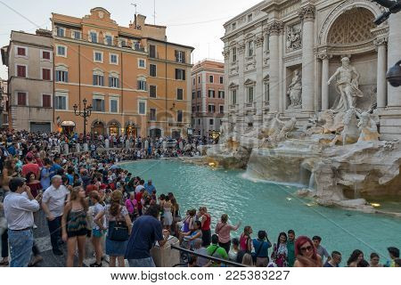 ROME, ITALY - JUNE 24, 2017: Sunset view of People visiting Trevi Fountain (Fontana di Trevi) in city of Rome, Italy