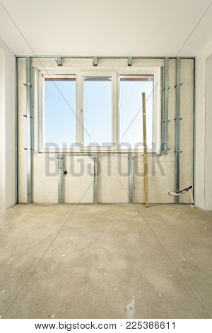 Workers are assembly gypsum wall. Construction plasterboard.