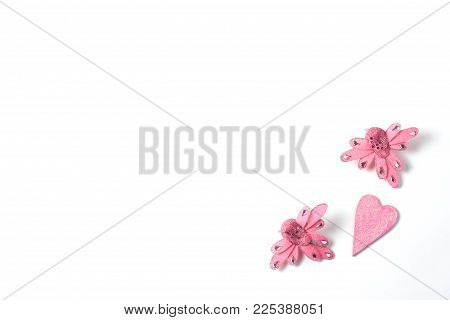 pink figures in the form of hearts and birds on a white background. minimal concept, flat lay, top view