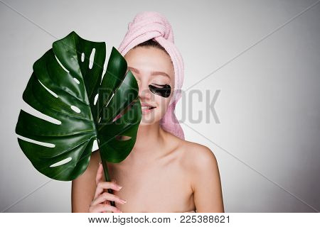 Happy Woman With A Towel On Her Head Struck Patches Under The Eyes