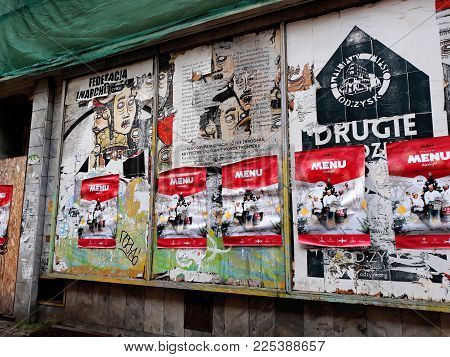 Poznan, Poland - December 02, 2017: Posters on an old building in Poznan