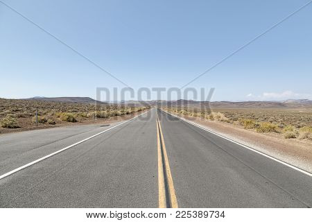 A Straight Highway Running Through Death Valley In California.