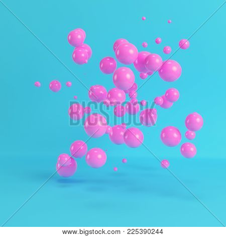 Pink flying spheres on bright blue background in pastel colors. Minimalism concept. 3d rendering