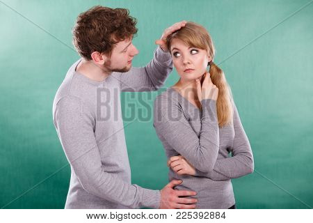 Depression And Sadness Concept. Unhappy Depressed Couple After Argument. Sad Woman And Disappointed